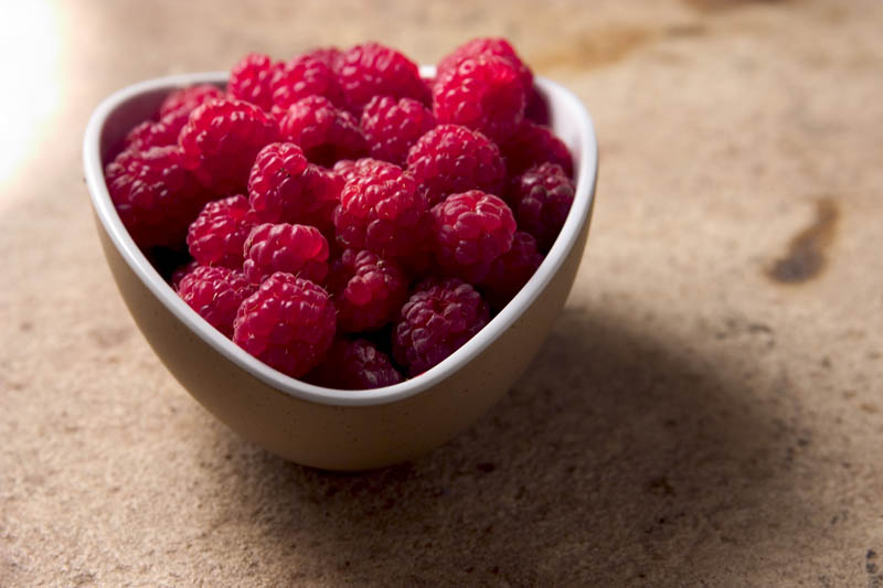 Picture of a bowl of garden fresh raspberries